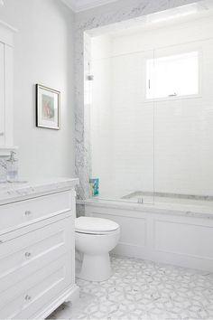 marble mosaic floor tiles, white vanity, marble bath surround