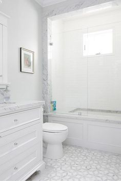 marble mosaic floor tiles, white vanity, marble bath surround