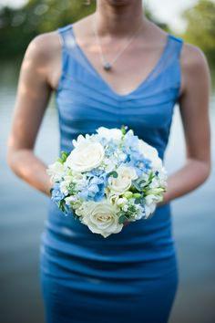 Blue themed wedding ideas. Blue flowers / bouquet and bridesmaid dress