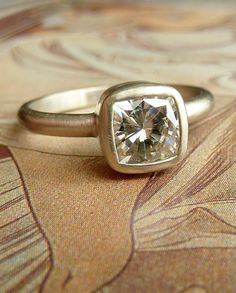 Kate Szabone - this ring is made with Moissanite, a man made stone with greater clarity and density than a diamond. Great, conscience alternative =)