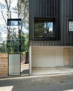 Charred wood facades and aluminium-clad window sills feature on Highgate home renovation