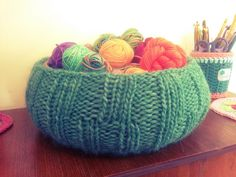 Yarn-bombed wooden fruit bowl used to store scrap yarn and mini-skeins at Crafts from the Cwtch blog.