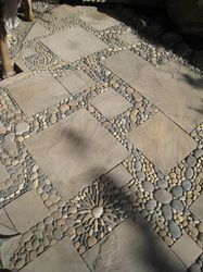 Made of pavers with a lacy tracery of river rock mosaic, this surface by MetaMosaics would be an elegant terrace, walkway, or even tabletop. And what a wonderful DIY project! For more projects, many using antique linens, see Our Favorite Ideas on mamasmiracle.com.