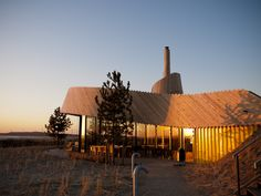 In a dune nature reserve bordering the second maasvlakte land reclamation project rises a new restaurant: 'Aan Zee´ It is a new type of restaurant. It is autarkic in many ways. It uses sun, wind, wood fire, natural convection and the earth itself a