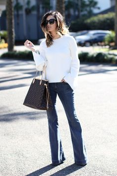 Bell sleeves + flare jeans make for the perfect chic, retro-inspired look via For All Things Lovely | Topshop bell sleeve top, James Jeans denim, Christina Louboutin shoes, Louis Vuitton handbag, Michele watch, David Yurman bracelet stack, and Celine sunnies