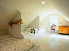 Beds on edge of slanted ceiling.  I don't actually have an attic room, but if I did this would be a good way to use it.