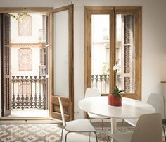 Okay - have you ever seen a more beautiful little dining space? Those wooden frames on the window-doors give instant class, but also a very welcoming, homely feel. The outlook is to die for and the whole mood is just perfect. By OAK 2000