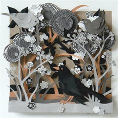 Beautiful cut paper sculpture with painted figures