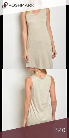 """Oatmeal Midi vneck asymetrical  dress This versatile oatmeal dress goes from office to weekend wear with little effort. Need a dress that packs and travel well? This is your go-to-must-have wardrobe item!!! Front has a rounded v neckline, asymmetrical hemline and material is as super soft. Feels so rich and flatters so many figures! I also have this dress in light grey in my closet. Approx S:B:17""""W:18""""L:33-35.5"""" M:B:18.5""""W:19""""L:33-36.5"""" L:B:20""""W:21""""L:34-37.5"""".  ✅I ship same or next day…"""