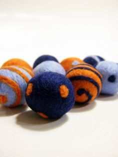 Orange,Baby Blue,Navy Blue Wool Felted beads. via Etsy.