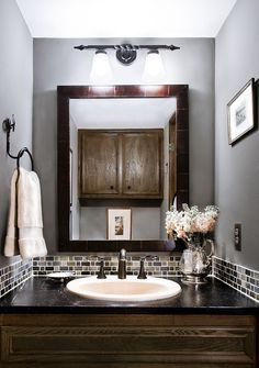 Really like the tile accent around the vanity - for a small bathroom!