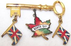 North Bay + red/yellow/green maple leaf + Union Jack flags [Canada key-shaped charm brooch / pin]
