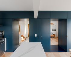 "Bureau Brisson Architectes updates Swiss ""hybrid"" home with blue storage"