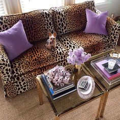 leopard sofa and brass tables @luxereportdesigns