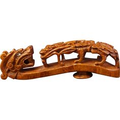 Chinese elm burl wood child's belt hook with dragon and cloud motif 19th century $350