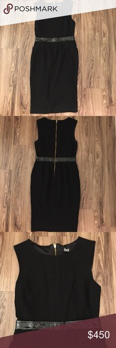 Dolce Gabbana black dress Beautiful black dress that falls a little bit above your knees. I wore it once pre baby body and now I can't zipped it up :( sad sad day. But I hope someone can rock this dress like I did! Comes with a built in belt in the center and tag of authenticity. Please ask any questions or concerns before buying. No trades please. Dolce & Gabbana Dresses Midi