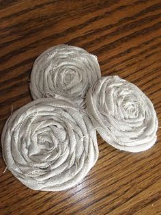 Fabric rosettes... I want to turn this into a headband or maybe a ribbon belt.