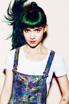 grimes' fringe like a rooster's tail feathers or a male duck's head