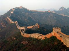 Great Wall, China -- I wanna go here. Not to do something crazy like walk the whole thing but it would be nice to have a picnic on like 30 feet of it...lol.