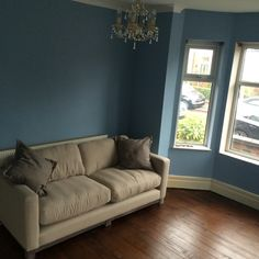 Floors sanded and varnished, sofa in, walls painted (Farrow and Ball's Lulworth Blue). So nice to see the house becoming a home!