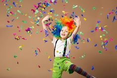 Little boy in clown wig jumping and having fun celebrating birth