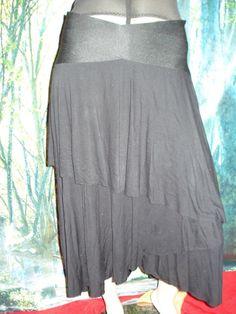 $8.00  size 14  43cm waist  86cm long  cotton lycra skirt,waist is firm