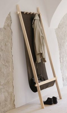 This minimalist coat rack provides extra storage at the bottom, and could be DIYed if you're handy!