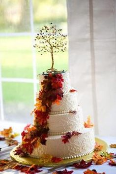 Beautiful Autumn Wedding Cake: This fantastic cake was made by Ohlsens Bakery in Clarence, NY. It is a white cake with buttercream frosting, swirled details, and silk leaves for decoration.