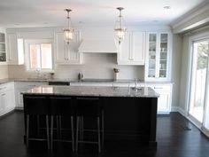 dark island with white kitchen5746 Elizabeth Ann Way, Fort Myers, FL 33912
