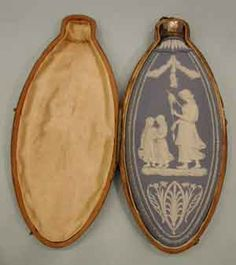 An 18th Century Wedgwood Perfume Flask, in pale blue jasper, sprigged with vignettes of different domestic scenes on each side.