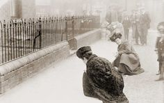 Suffragettes Emma Sproson (left) and a friend chalking the pavement, LONDON 1907