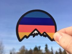 Sunset Mountain designed by Nick Stewart. Connect with them on Dribbble; Arches Np, Harry Potter Stickers, Swamp Creature, Mountain Sunset, Mountain Designs, Craft Stickers, Badge Logo, Paris Eiffel Tower, Silver Spring