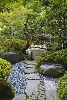 A careful balance between the natural and the engineered characterizes Japanese gardens. This path exemplifies that balance. Note the mix of squared stones and rough stones, patterns and no patterns, alternate textures--it's all very careful and deliberate.