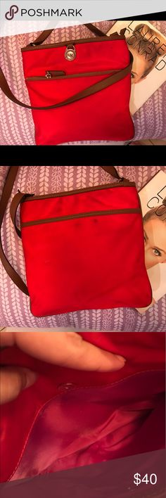 """Michael korks  Large Nylon red crossbody bag❤️ Kempton Large Nylon Crossbody  This bag is preowned and the price reflect this the exterior shows some wear but it's hard to see . -100% Nylon  -Silver-Tone Hardware  -9 7/8"""" X 1 1/8"""" X 10 2/8""""  -Adjustable Drop: 21""""-23""""  -Exterior: One Zip Pocket, One Open Pocket  -Interior: One Zip Pocket, Three Open Pockets  -Lining: 100% Nylon  -Imported Michael Kors Bags Crossbody Bags"""