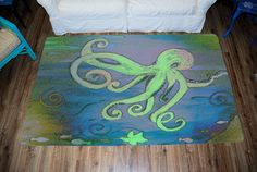 Blue green octopus coastal sea life beach area rug Plush Area Rug from my art Art appears on the top side, which is made of a soft plush fabric. Bottom is made of durable white rubber mat with rounded