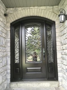 Beautiful home features gorgeous #handmade #custommade #mahogany #AmberwoodDoor #entrance - Dual clear glass; external Wrought Iron; Brown Mahogany stain; lovely #Emtek lockset. Call or come into Amberwood's outstanding #showroom today and discover your dream #doors 416-213-8007 #AmberwoodDoors proudly ships #worldwide - Call today for shipping details! 1-800-861-3591 #IHaveThisThingWithDoors #DoorsOfToronto #DoorsOfDistinction #DoorsOfTheWorld #CurbAppeal