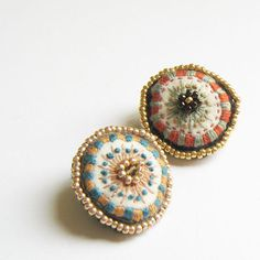 embroidered flower on a brooch.