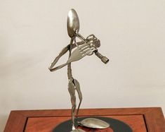 The Trumpet Player - made from silverware and mounted on a 45 record. Welded Art, Trumpet Players, 45 Records, Welding, Metal Art, Sculpture, Etsy, Soldering, Sculpting
