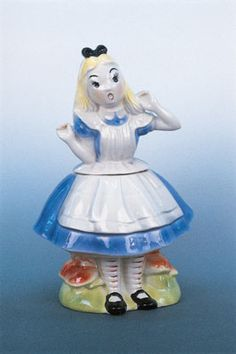 "Alice in Wonderland by Regal China, 13 1/4 inches tall, late 1950s, marked ""Walt Disney Productions Copyright (symbol) Alice in Wonderland,""..."