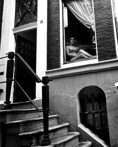 1960's. A prostitute in the window of a canal house in the red light district of Amsterdam. Photo Cor Jaring. #amsterdam #1960.