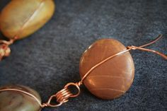 How to make a rain chain from copper wire and polished st... - Quora