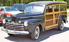 1946 Ford - Like most of the other car manufacturers re-tooling for post-war consumer production, Ford retained the basic design of the 1942 model year for the 1946 model year. Ford changed the grille to a series of horizontal bars that covered the rectangular opening that housed the grille in 1942. Ford eliminated their low-priced Special sixes, which left them with six- and eight-cylinder DeLuxe and Super DeLuxe models.