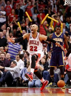 Chicago Bulls forward Taj Gibson (22) celebrates after his dunk off a rebound during the second half against the Indiana Pacers Monday in Chicago. The Bulls won 89-77. (Charles Rex Arbogast/AP)