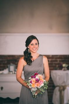 Lovely bridesmaid style: side-swept hair + grey one-shoulder J. Crew dress + colourful bouquet