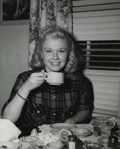 Doris Day, enjoying a cup of coffee!