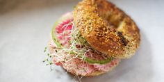 Black Seed Bagel - Tobiko caviar cream cheese topped with watermelon radish & sprouts 170 Elizabeth Street NYC 212-730-1950