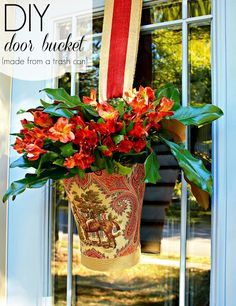 Turn a plastic trash can into a fresh flower vase for your door (You did a great job!  I love this idea!)