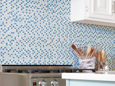"""""""Here's the place to make a statement and tie your whole color scheme together. This mosaic tile — a mix of glass and stone — had all the colors we used in the room, and it came in 12-inch x 12-inch sheets that were easy to install without any special cuts,"""" says Sarah. Get the look: Merola Rustica subway porcelain tile in neptune blue, $17 per sheet (11¾"""" x 11¾""""), homedepot.com"""