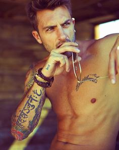 Don't know who he is, but GOLL-Y he's yummy!