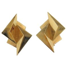 A pair of 14k yellow gold geometric earrings.